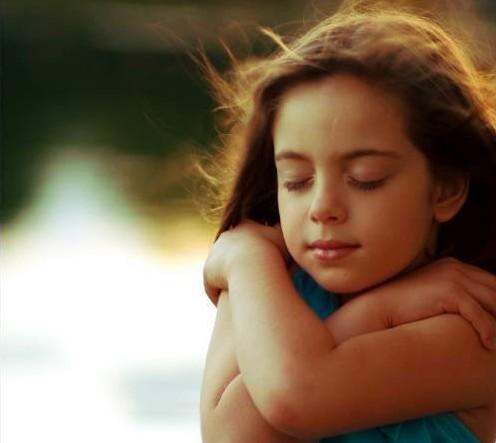 Girl-hugging-herself